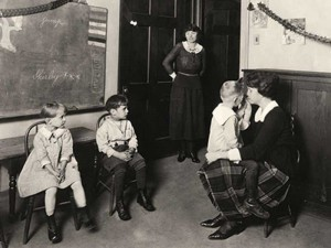 early CID classroom with 4 students and 2 teachers, showing small class size and one-on-one instruction