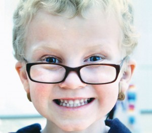 Peter with glasses and cochlear implants