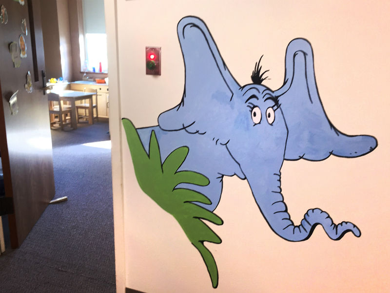 elephant mural in outside CID family center toddler class